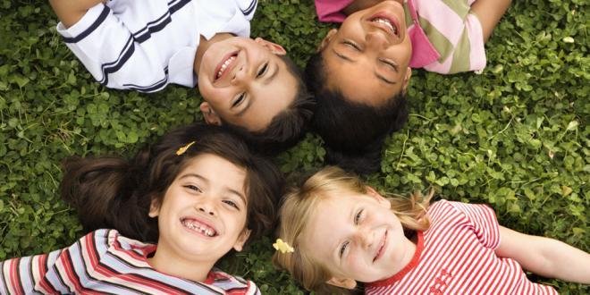 children laying in grass